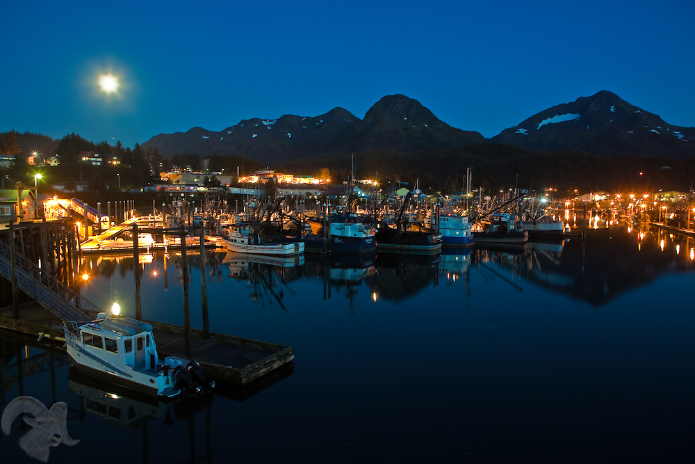 The full moon rises over the Cordova, Alaska harbor and the Heney Mountain range. Cordova is located on  on the eastern shores of Prince William Sound, on Alaska's north gulf coast.