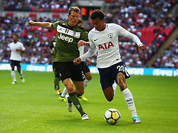 August 5, 2017 - London, England, United Kingdom - Tottenham Hotspur's Dele Alli holds of Stephan Lichtsteiner of Juventus FC.during the Friendly match between Tottenham Hotspur and Juventus at Wembley stadium, London, England on 5 August 2017. (Credit Image: © Kieran Galvin/NurPhoto via ZUMA Press)