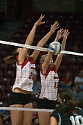 19 AUG 2006 Kari Staehlin (l) and Mary McGinnis (r) get the block on a strike by the Huskies. Northern Illinois Huskies got slammed by Illinois State Redbirds, losing the match 3 games to 1. Game action took place at Redbird Arena on the campus of Illinois State University in Normal Illinois.
