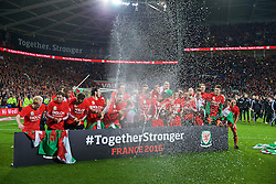 CARDIFF, WALES - Tuesday, October 13, 2015: Wales players celebrate qualifying for the finals after a 2-0 victory over Andorra during the final UEFA Euro 2016 qualifying Group B match at the Cardiff City Stadium. (Pic by Barry Coombs/Propaganda)