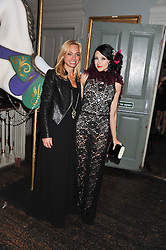 Left to right, DEANNA BERKELEY and STACEY BENDET at a carnival themed party hosted by Stacey Bendet for the Alice & Olivia fashion label at Paradise, Kensal Green, London on 9th November 2011