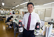 Michihiro Kono, president of a soy sauce and miso soup maker Yagisawa Shoten, poses with bottles of soy sauce in the temporary offices of his family's 204-year-old company in Ichinoseki, Iwate Prefecture, Japan on 05 Sept. 2011. Photograph: Robert Gilhooly