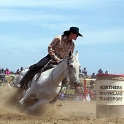 Angie Perkins from Wanaka in action during the Open Barrel Race at the Southland Rodeo, Invercargill,  New Zealand. 29th January 2012