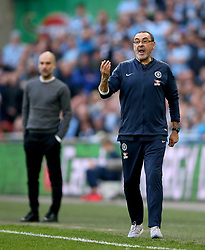 Chelsea manager Maurizio Sarri (right) gestures on the touchline during the Carabao Cup Final at Wembley Stadium, London.