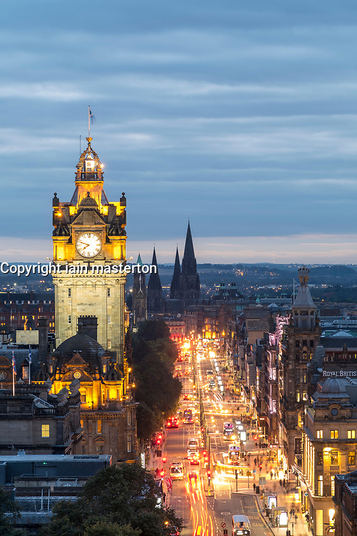 View along busy Princes Street at dusk in Edinburgh, Scotland, United Kingdom.