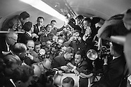 1960. Impromptu  press conference in dining car of french train on the way to Verdun.<br />