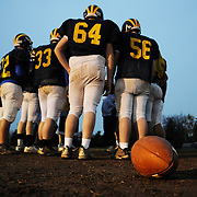 Kennedy-Kenrick High School's football team huddles up for one of the last practices they will ever have before the end of the season and the closing of the school at the end of the academic year. Budget constraints within the Philadelphia Archdiocese forced the closure of several Catholic schools throughout the region.