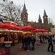 Shoppers enjoy a hliday staple of the christmas markets - gluhwein in the Kasiserslautern Christmas market