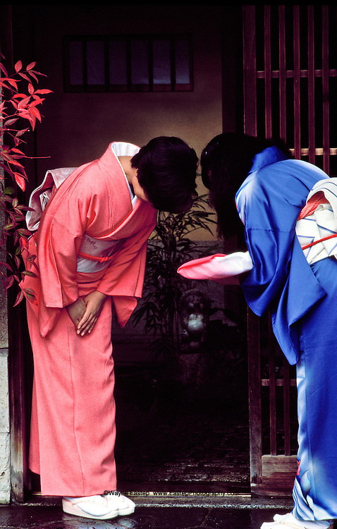 Traditional Japanese greeting arriving at home, Kyoto, Japan