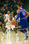 WACO, TX - JANUARY 7: Kenny Chery #1 of the Baylor Bears defends against Frank Mason III #0 of the Kansas Jayhawks on January 7, 2015 at the Ferrell Center in Waco, Texas.  (Photo by Cooper Neill/Getty Images) *** Local Caption *** Kenny Chery