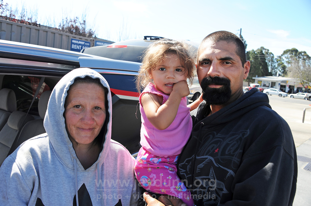 Victoria, Adalasia, and Ricardo outside their van, temporarily parked at the Exxon station in Salinas.