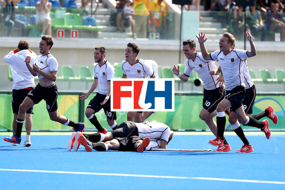 RIO DE JANEIRO, BRAZIL - AUGUST 18:  Christopher Wesley #10, Moritz Trompertz #7, Linus Butt #3 and Martin Zwicker #20 of Germany run upfield after defeating Netherlands in a penalty shootout during the Men's Hockey Bronze  medal match at the Olympic Hockey Centre on Day 13 of the 2016 Rio Olympic Games on August 18, 2016 in Rio de Janeiro, Brazil.  (Photo by Sean M. Haffey/Getty Images)