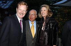 Left to right, the EARL OF DERBY and MR & MRS URS SCHWARZENBACH at the Cartier Chelsea Flower Show dinat the annual Cartier Flower Show Diner held at The Physics Garden, Chelsea, London on 23rd May 2005.<br />
