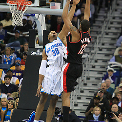02 February 2009: Portland Trailblazers forward LaMarcus Aldridge (12) shoots over New Orleans Hornets forward David West (30) during a 97-89 loss by the New Orleans Hornets to the Portland Trail Blazers at the New Orleans Arena in New Orleans, LA.