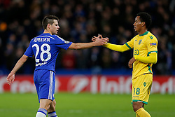 Cesar Azpilicueta of Chelsea commiserates Andre Carrillo of Sporting after Chelsea win 3-1 - Photo mandatory by-line: Rogan Thomson/JMP - 07966 386802 - 10/12/2014 - SPORT - FOOTBALL - London, England - Stamford Bridge - Sporting Clube de Portugal - UEFA Champions League Group G.