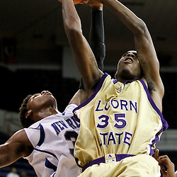 November 27, 2011; New Orleans, LA; Alcorn State Braves forward KeDorian Sullivan (35) has his shot blocked by New Orleans Privateers guard Rarlensee Nelson (3) during the second half of a game at the Lakefront Arena. New Orleans defeated Alcorn St. 63-56. Mandatory Credit: Derick E. Hingle-US PRESSWIRE