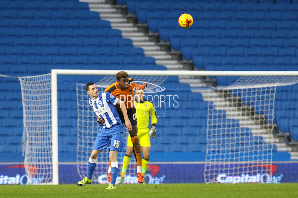 Wolverhampton Wanderers defender Dominic Iorfa (18) heads clear during the Sky Bet Championship match between Brighton and Hove Albion and Wolverhampton Wanderers at the American Express Community Stadium, Brighton and Hove, England on 1 January 2016. Photo by Phil Duncan.