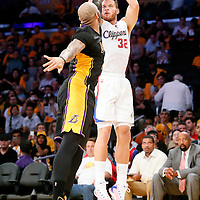 31 October 2014: Los Angeles Clippers forward Blake Griffin (32) takes a jump shot over Los Angeles Lakers forward Carlos Boozer (5) during the Los Angeles Clippers 118-111 victory over the Los Angeles Lakers, at the Staples Center, Los Angeles, California, USA.