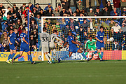 AFC Wimbledon goalkeeper Nathan Trott (1) about to save shot during the EFL Sky Bet League 1 match between AFC Wimbledon and Portsmouth at the Cherry Red Records Stadium, Kingston, England on 19 October 2019.
