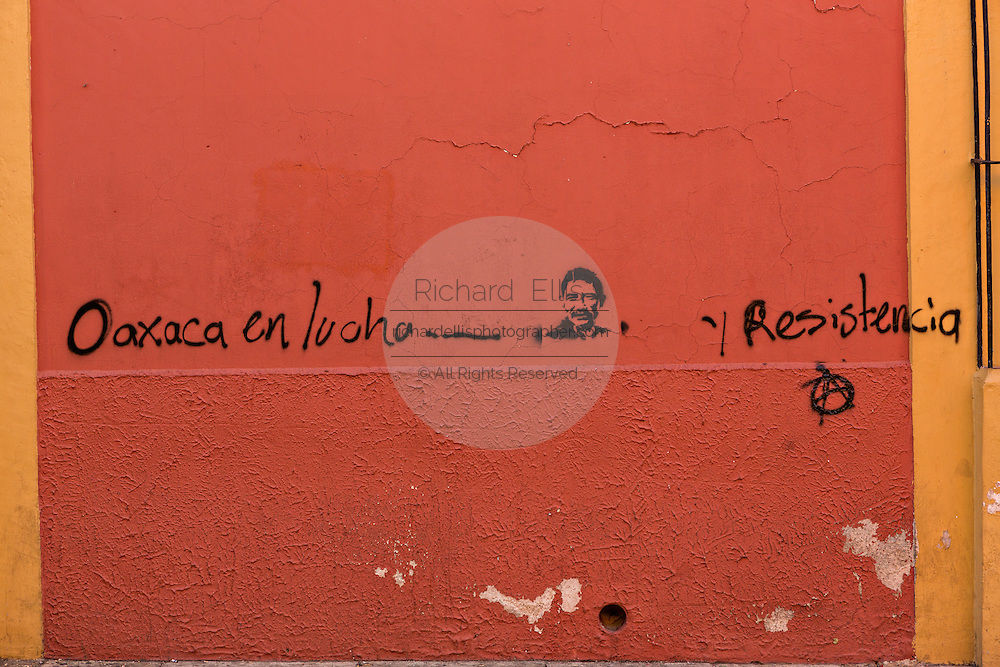Political graffiti for the Oaxaca Resistance on the Alcala in the historic district October 30, 2013 in Oaxaca, Mexico.