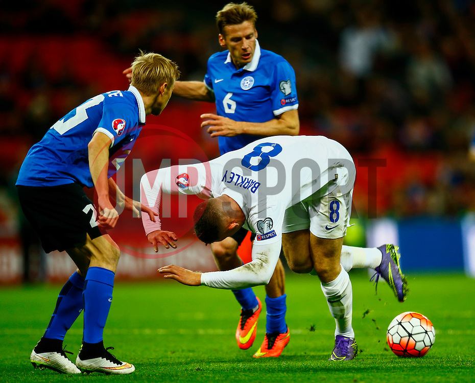 Ross Barkley of England is tackled by Aleksandr Dmitrijev of Estonia - Mandatory byline: Jason Brown/JMP - 07966 386802 - 09/10/2015- FOOTBALL - Wembley Stadium - London, England - England v Estonia - Euro 2016 Qualifying - Group E
