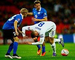 Ross Barkley of England is tackled by Aleksandr Dmitrijev of Estonia - Mandatory byline: Jason Brown/JMP - 07966 386802 - 09/10/2015- FOOTBALL - Wembley Stadium - London, England - England v Estonia - Euro 2016 Qualifying - Group E