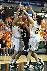 19 March 2010: Carrie Snikkers tries to force her way to the open hoop through Jodie Luther and Melissa Alwardt. The Flying Dutch of Hope College defeat the Yellowjackets of the University of Rochester in the semi-final round of the Division 3 Women's Basketball Championship by a score of 86-75 at the Shirk Center at Illinois Wesleyan in Bloomington Illinois.