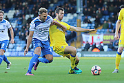 AFC Wimbledon defender Chris Robertson (34) clears before Bury FC striker Hallam Hope (24) gets the ball during the The Emirates FA Cup 1st Round match between Bury and AFC Wimbledon at the JD Stadium, Bury, England on 5 November 2016. Photo by Stuart Butcher.