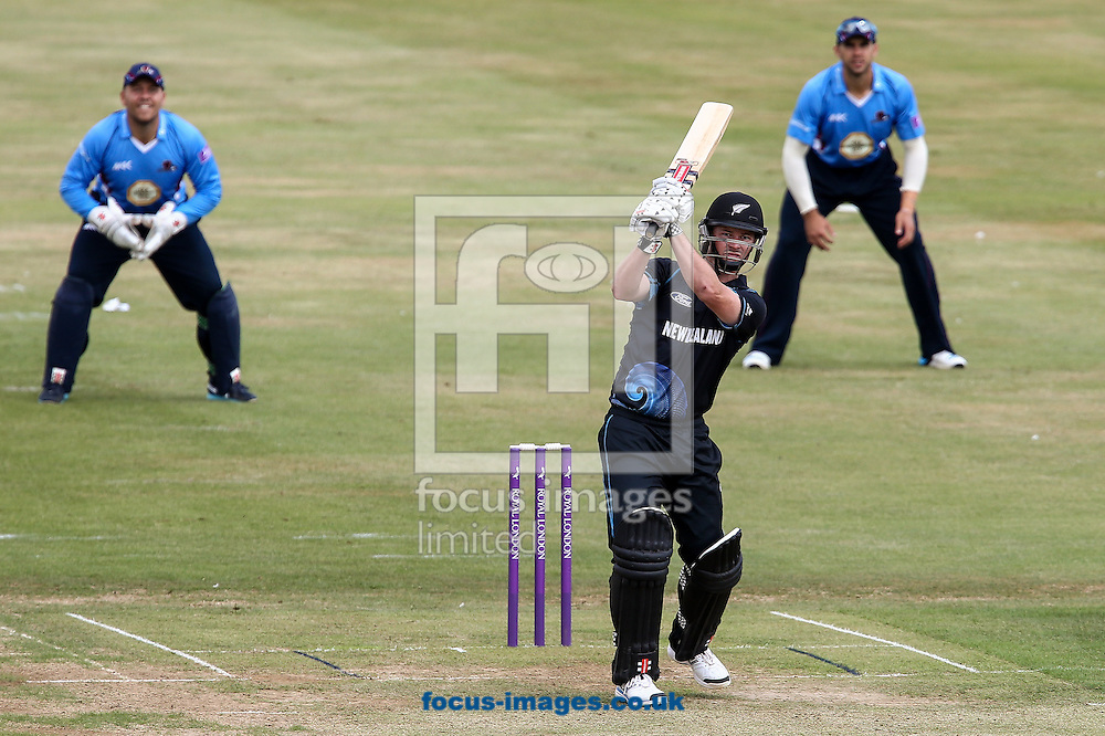 Colin Munro of New Zealand A hits the ball to the boundary for four during the Tour Match match at the County Ground, Northampton, Northampton<br /> Picture by Andy Kearns/Focus Images Ltd 0781 864 4264<br /> 31/07/2014