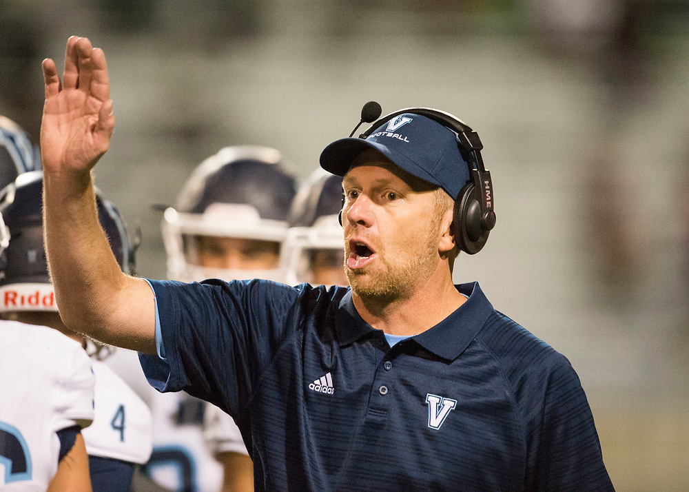 ARVADA - SEPT. 22: Valor Christian head football coach Rod Sherman gestures during a huddle while playing Pomona in a Class 5A nonconference high school varsity football game held at the North Area Athletic Complex. (Photo by Andy Colwell/ Special to The Denver Post)