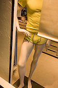 Male mannequin with hand on hip, posed in an Italian shop window.