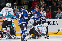 KELOWNA, CANADA - APRIL 14: Tyler Soy #17 of Victoria Royals loses his helmet after a check by Rodney Southam #17 of Kelowna Rockets in the second period on April 14, 2016 at Prospera Place in Kelowna, British Columbia, Canada.  (Photo by Marissa Baecker/Shoot the Breeze)  *** Local Caption *** Rodney Southam; Tyler Soy;