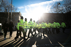 "© Licensed to London News Pictures . 26/11/2016 . Bolton , UK . Police at the demonstration . Approximately 100 people attend a demonstration against the construction of mosques in Bolton , under the banner "" No More Mosques "" , organised by a coalition of far-right organisations and approximately 150 anti fascists opposing the demonstration , in Victoria Square in Bolton Town Centre . Photo credit : Joel Goodman/LNP"