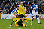 Chesham United defender Curtis Ujah attempts to clear from Bristol Rovers striker Matt Taylor during the The FA Cup match between Bristol Rovers and Chesham FC at the Memorial Stadium, Bristol, England on 8 November 2015. Photo by Alan Franklin.