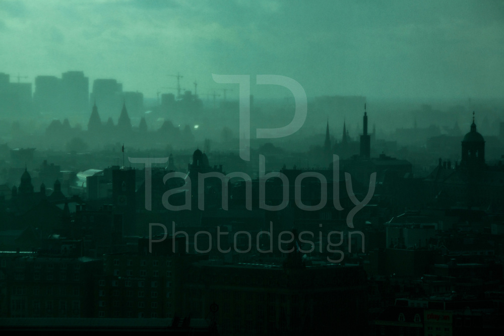 Amsterdam old city as seen from a viewing platform of the A'DAM Toren skyscraper in the Noord district of Amsterdam, Netherlands, on November 2016. The old city of Amsterdams appear in a mysterious spooky scenery during a heavy rain storm that lasted for 40 minutes. The district of Amsterdam Noord is taking off where the A'dam Toren is located should be the future alternative to avoid the high housing costs in the center of Amsterdam and in search of better values or lower rents.