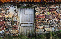Front door detail of abandoned croft house near Lochmaddy, North Uist, Outer Hebrides, Scotland<br /> <br /> (c) Andrew Wilson | Edinburgh Elite media