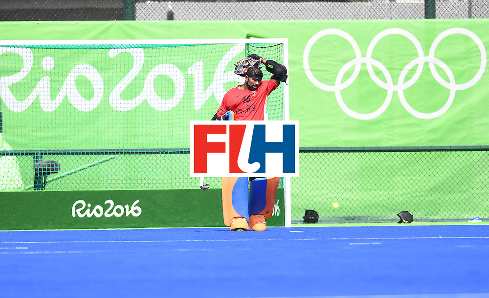 India's goalkeeper Sreejesh Parattu takes off his protective headgear during the men's field hockey Argentina vs India match of the Rio 2016 Olympics Games at the Olympic Hockey Centre in Rio de Janeiro on August, 9 2016. / AFP / MANAN VATSYAYANA        (Photo credit should read MANAN VATSYAYANA/AFP/Getty Images)