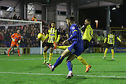 Callum Kennedy of AFC Wimbledon tries a lob during the Sky Bet League 2 match between AFC Wimbledon and Dagenham and Redbridge at the Cherry Red Records Stadium, Kingston, England on 24 November 2015. Photo by Stuart Butcher.