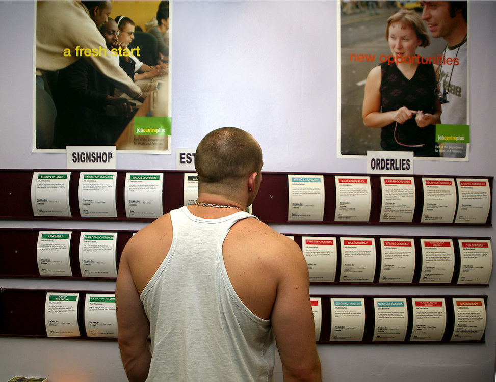 A prisoner looks at available jobs within the prison at the job centre of Coldingley prison..HMP Coldingley, Surrey was built in 1969 and is a Category C training prison. Coldingley is focused on the resettlement of prisoners and all prisoners must work a full working week within the prison. Its capacity is 390 prisoners.