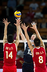 13.09.2014, Centennial Hall, Breslau, POL, FIVB WM, Finnland vs China, 2. Runde, Gruppe F, im Bild Jingtao Xu china #14 Mikko Oivanen finland #13 Jianjun Cui china #8 // On the picture: Jingtao Xu china #14 Mikko Oivanen finland #13 Jianjun Cui china #8 during the FIVB Volleyball Men's World Championships 2nd Round Pool F Match beween Finland and China at the Centennial Hall in Breslau, Poland on 2014/09/13. EXPA Pictures © 2014, PhotoCredit: EXPA/ Newspix/ Sebastian Borowski<br /> <br /> *****ATTENTION - for AUT, SLO, CRO, SRB, BIH, MAZ, TUR, SUI, SWE only*****