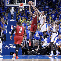 12 June 2012:  Oklahoma City Thunder shooting guard Thabo Sefolosha (2) blocks Miami Heat small forward Shane Battier (31) during the Oklahoma City Thunder 105-94 victory over the Miami Heat, in Game 1 of the 2012 NBA Finals, at the Chesapeake Energy Arena, Oklahoma City, Oklahoma, USA.