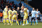 Goal scorer Millwall FC defender Byron Webster (17)  argues wit the referee after Millwall FC midfielder Shaun Williams (6) is sent off and receives a red card  during the Sky Bet League 1 match between Coventry City and Millwall at the Ricoh Arena, Coventry, England on 16 April 2016. Photo by Simon Davies.