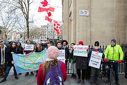 London, UK. 9th January, 2019. Claire James, Campaigns Coordinator of the Campaign Against Climate Change, addresses environmental campaigners protesting outside the Canadian High Commission in solidarity with the Wet'suwet'en, a First Nations people from British Columbia who are currently facing forced eviction after having blocked the construction by TransCanada of a fracked gas pipeline across their territories.