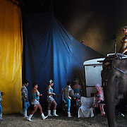 An elephant and its handler prepare for their performance backstage at the Cole Brother Circus.