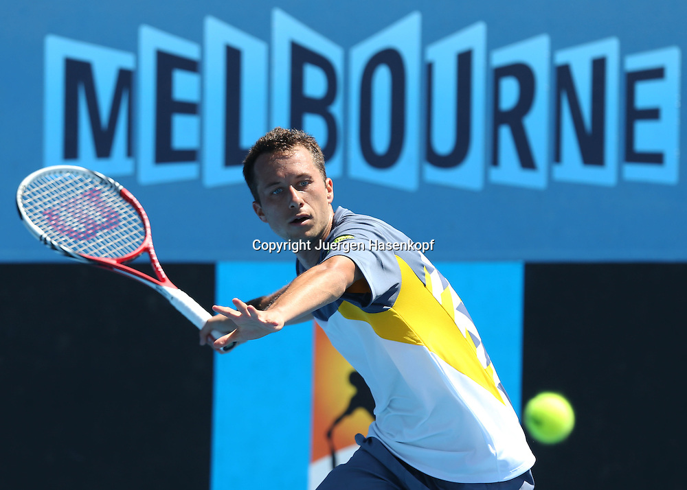 Australian Open 2013, Melbourne Park,ITF Grand Slam Tennis Tournament,.Philipp Kohlschreiber (GER),Aktion,Einzelbild,Halbkoerper,Querformat, .Melbourne Schriftzug im Hintergrund,Logo,.