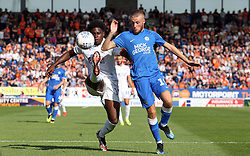 George Cooper of Peterborough United in action with Pelly Ruddock of Luton Town - Mandatory by-line: Joe Dent/JMP - 18/08/2018 - FOOTBALL - ABAX Stadium - Peterborough, England - Peterborough United v Luton Town - Sky Bet League One