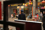 Street life seen through a shop window, Pingyao, People's Republic of China