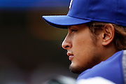 MINNEAPOLIS, MN - APRIL 15: Yu Darvish #11 of the Texas Rangers looks on during the game against the Minnesota Twins at Target Field on April 15, 2012 in Minneapolis, Minnesota. (Photo by Joe Robbins)