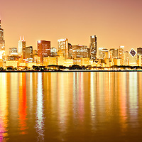 2011 Chicago skyline at night photo with Lake Michigan lakefront and downtown city buildings including 311 South Wacker Drive Building, Sears Tower / Willis Tower (233 South Wacker Drive), Hilton Chicago (720 South Michigan Avenue), Renaissance Blackstone Hotel (636 S. Michigan Avenue), The Congress Plaza Hotel (520 South Michigan Avenue), Franklin Center / AT&T Corporate Center (227 West Monroe Street), Roosevelt University Building (425 South Wabash Avenue), CNA Center Building (333 South Wabash Avenue), Chase Tower (10 South Dearborn Street), Santa Fe Building / Railway Exchange Building (224 South Michigan Avenue), Borg-Warner Building (200 South Michigan Avenue), Mid-Continental Plaza (55 East Monroe Street), The Heritage at Millennium Park (130 North Garland Court), United Airlines Building (77 West Wacker Drive), Pittsfield Building (55 East Washington Street), Leo Burnett Building (35 West Wacker Drive), Kemper Building / Unitrin Building (1 East Wacker Drive), Smurfit-Stone Building (150 N. Michigan Avenue), AMA Building (330 North Wabash formerly IBM Building), One Prudential Plaza Building (130 East Randolph Street), Trump International Hotel and Tower Building (401 North Wabash Avenue), Two Prudential Plaza Building (180 North Stetson Avenue), Aon Center Building (200 East Randolph Street)
