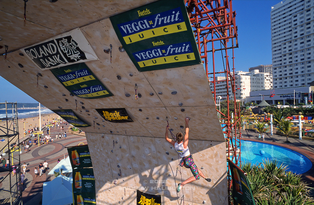 Steven Bradshaw competes in the Veggi-Fruit Open climbing competition, July 1995, Durban Beachfront, KwaZulu-Natal, South Africa.  Nikon F90, 28-70/3.5.  Fuji RVP Velvia 50.